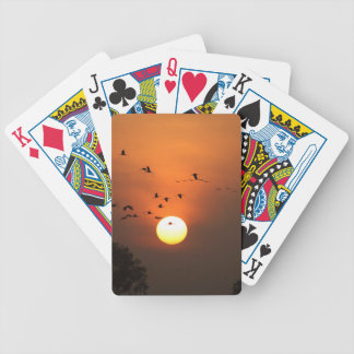 Sunrise with flocks of flying cranes bicycle playing cards
