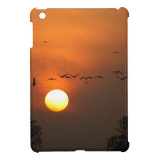 Sunrise with flocks of flying cranes iPad mini cases