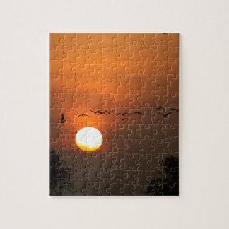 Sunrise with flocks of flying cranes jigsaw puzzle