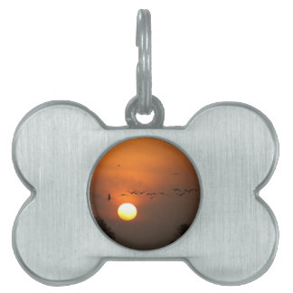 Sunrise with flocks of flying cranes pet name tag
