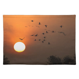Sunrise with flocks of flying cranes placemat