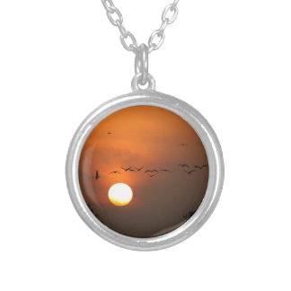 Sunrise with flocks of flying cranes silver plated necklace