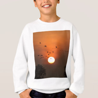 Sunrise with flocks of flying cranes sweatshirt