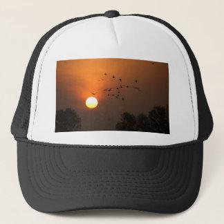 Sunrise with flocks of flying cranes trucker hat