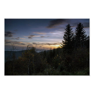 Sunset above the mountain forests poster