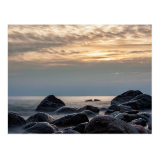 Sunset and stones on the Baltic Sea coast Postcard