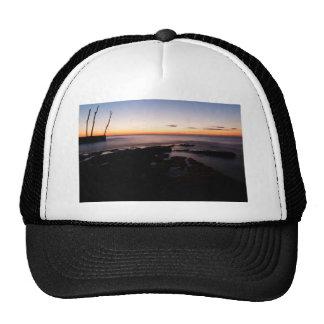 Sunset at basanija trucker hat