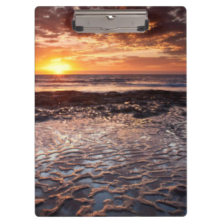 Sunset at the beach, California Clipboards