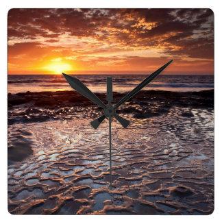 Sunset at the beach, California Wall Clocks