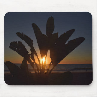 Sunset between palm leaves mousepad