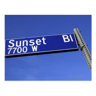 Sunset Boulevard sign against a blue sky Postcard