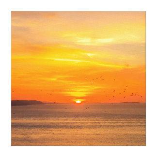 Sunset  Coast with Orange Sun and Birds Canvas Print