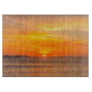 Sunset Coast with Orange Sun and Birds Cutting Board