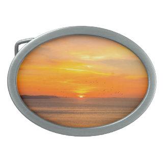 Sunset Coast with Orange Sun and Birds Oval Belt Buckle
