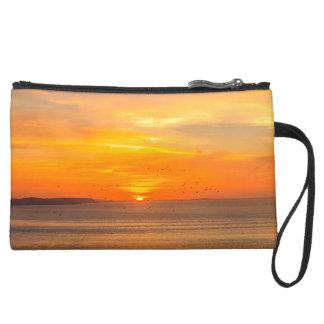 Sunset Coast with Orange Sun and Birds Suede Wristlet