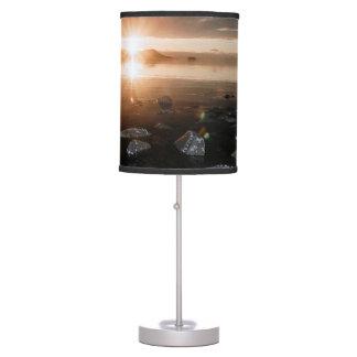 Sunset falls upon the beach lamp