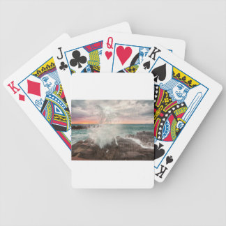 Sunset from a rocky beach bicycle playing cards