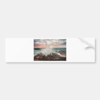 Sunset from a rocky beach bumper sticker