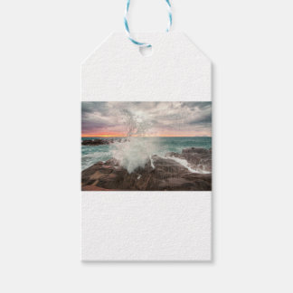 Sunset from a rocky beach gift tags