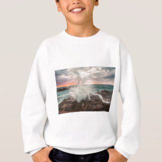 Sunset from a rocky beach sweatshirt