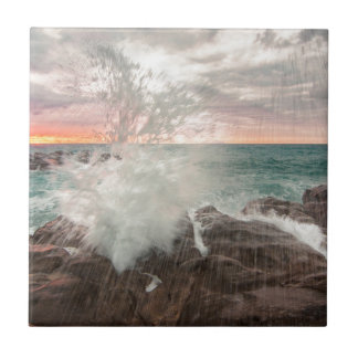 Sunset from a rocky beach tile