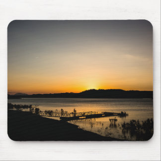 Sunset on a lake with a jetty in the foreground mouse pad