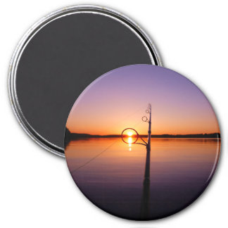 Sunset on a summer lake seen through a fishing rod 3 inch round magnet
