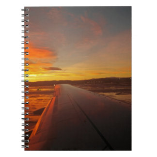 Sunset on Airplane wing Notebooks