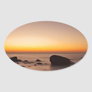 Sunset on shore of the Baltic Sea Oval Stickers