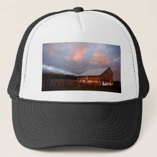 Sunset on the old barn trucker hat