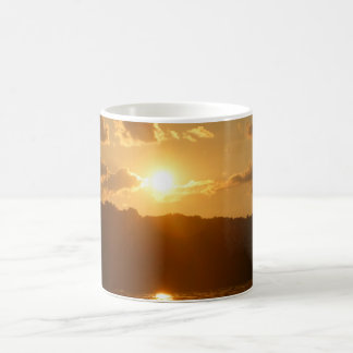 Sunset  on  the tree line on the water morphing mug