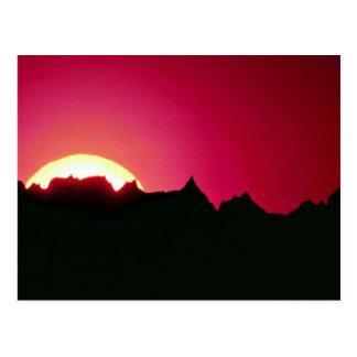 Sunset over Badlands peak Postcard