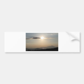 Sunset over mountains bumper sticker