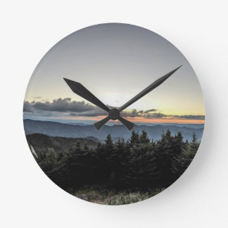sunset over mountains clocks