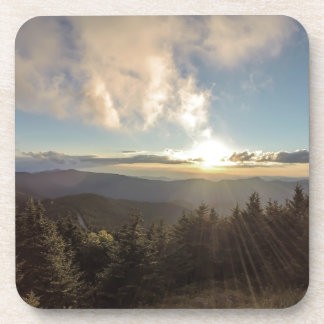 sunset over mountains coasters