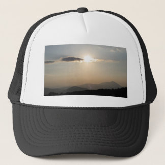 Sunset over mountains trucker hat