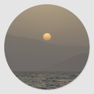 Sunset over Paros island mountains Classic Round Sticker