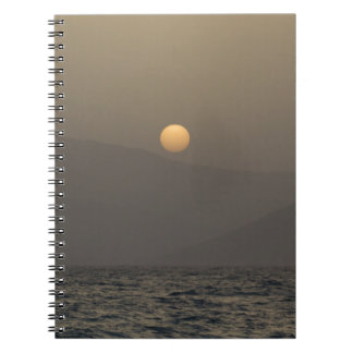 Sunset over Paros island mountains Notebooks