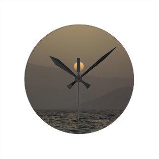 Sunset over Paros island mountains Round Clock