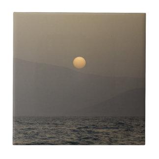 Sunset over Paros island mountains Tile