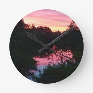 Sunset Reflections Before the Storm Round Clock