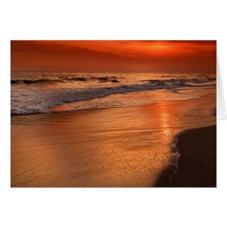 Sunset reflections off clouds and ocean shore card