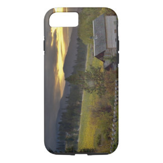 Sunset sky over vineyards and historic log cabin iPhone 7 case