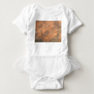 Sunset through clouds. baby bodysuit