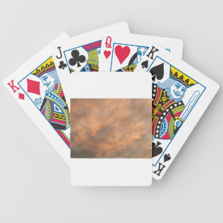 Sunset through clouds. bicycle playing cards