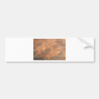 Sunset through clouds. bumper sticker