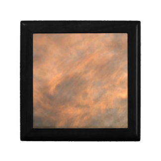Sunset through clouds. gift box