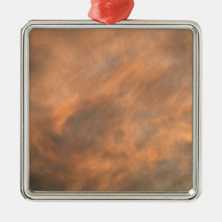 Sunset through clouds. metal ornament