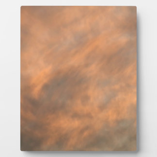 Sunset through clouds. plaque