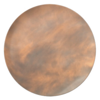 Sunset through clouds. plate